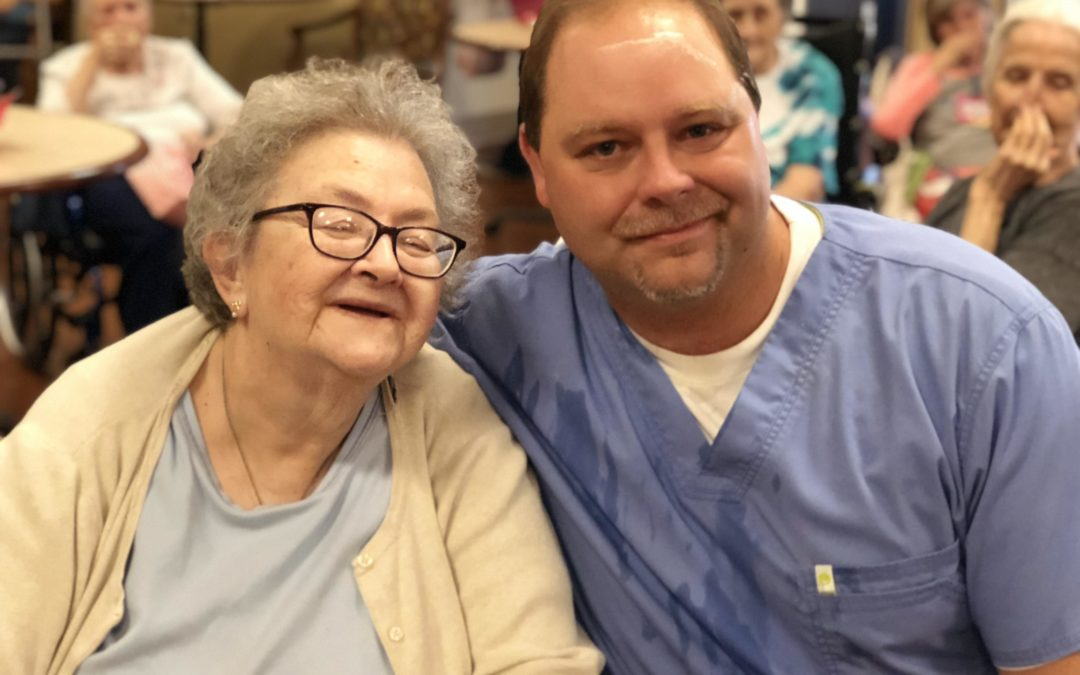 Jefferson Park employee sitting with a resident who has chosen an east tennessee skilled nursing care facility